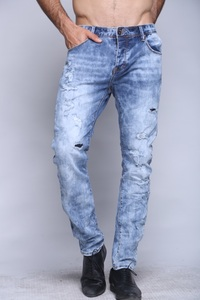 canavaro light blue stone washed skinny jeans with all over scratches